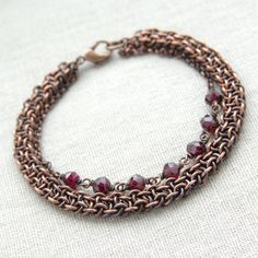 Copper chainmaille bracelet with faceted red garnet beads.    Length of the bracelet: 7,48 (19cm)   If you need this bracelet to be resized, please message