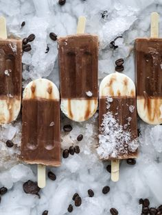 These fudgesicles are made with cold brew and dutch process cocoa for the most fun grown-up popsicle that can also deliver a little caffeine jolt. Topped with vanilla bean sweet cream, these are just like an iced latte in a pop! Serve as a treat or a snack! I howsweeteats.com #coldbrew #coffee #sweet #cream #popsicle #fudgesicle