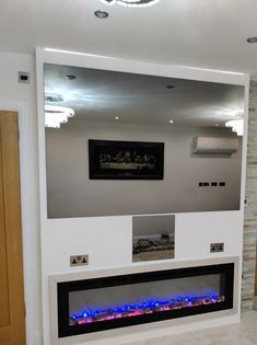 Bespoke Frameless Mirror TV with matching games console concealment and fireplace! Mirror Tv, Frameless Mirror, Matching Games, Living Area, Bespoke, Framed Art, Console, Frames, Decor