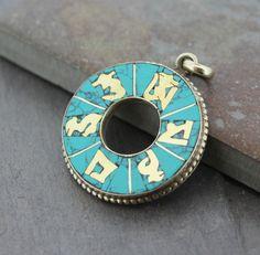 Dharmashop.com - Om Mani Turquoise Pendant, $35.00 (http://www.dharmashop.com/om-mani-turquoise-pendant/)