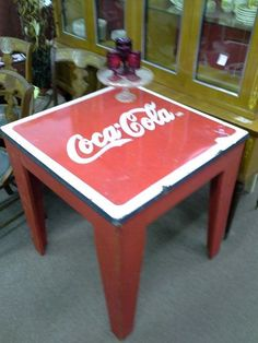 $189 - This vintage wooden table has a enamel coca cola sign as table top. The table measures 29 inches by 29 inches square. The wooden table base has been painted red. It stands 31 inches tall.  It can be seen in booth D 12 at Main Street Antique Mall 7260 East Main St ( E of Power Rd ) Mesa 85207  480 9241122open 7 days 10 till 530 Cash or charge 30 day layaway also available