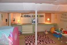 Our awesome basement playroom with fabric ceilings