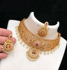 Aashkaanya is an Online Traditional Indian Imitation Jewelry Boutique. The new destination for your shopping hub. Explore all collection for new designs and more colors. Let's Show The World You Shine. Jewelry Design Earrings, Gold Earrings Designs, Gold Jewellery Design, Necklace Designs, Jewelry Sets, Fancy Jewellery, Temple Jewellery, Pendant Jewelry, Gold Wedding Jewelry