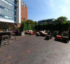 """Learn how we helped the Alibi Bar & Grill of Boston transform their patio from okay to """"let's stay for another round! Artificial Hedges, Artificial Plants, Patio Makeover, Bar Grill, Commercial Design, Boston, Hot, Outdoor Decor, Home Decor"""