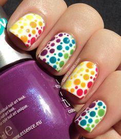 Rainbow Dots. Pretty but a bit too much for me... I'd do one accent nail in monochromatic tones, teals maybe?