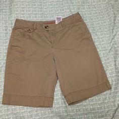 "Dockers khaki shorts, size 12 Dockers khaki Bermuda shorts, button and clasp close. Inseam 9"". Rise 10.5"" Dockers Shorts Bermudas"