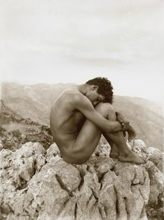 """Photograph of a youth Sicily (c. 1902) by Baron Wilhelm von Gloeden (1856-1931).    The image was titled """"Cain"""" and echoes a remorseful, lonely pose made famous by the French painter Jean-Hippolyte Flandrin."""