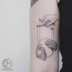 Surrealist puppet tattoo on the right bicep. Artista Tatuador: Karry Ka-Ying Poon · Poonkaros