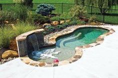 Small swimming pool with waterfall and sun shelf. Add endless swimming and this…