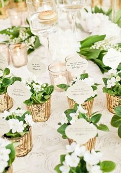 pretty little golden favors: could plant herbs, small blooms, fill with fresh cut flowers, etc!
