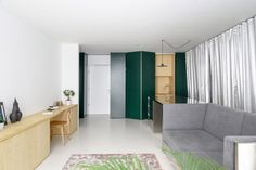 Arhitektura d.o.o has fit out this apartment in the Slovenian capital with metallic moveable furniture so its owners can adapt the layout to suit their busy social lives. Apartment Entrance, One Bedroom Apartment, Living Area, Living Spaces, Silver Curtains, Design A Space, Terrazzo Flooring, Apartment Interior Design, Arch Interior
