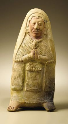 Pre-Columbian:Ceramics, Figure of a Standing Woman. Maya, Jaina. A.D. 550 - 900. Ceramic,traces of original red paint. Height 10 5/8 in. Width 4 7/...