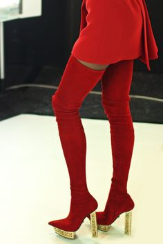 In keeping with the current over the knee obsession in boots, this season Donatella Versace gave her own version in bright patent leather and short chunky heel paired perfectly with a dress made specifically to highlight the leg. [Photo by Kuba Dabrowski]