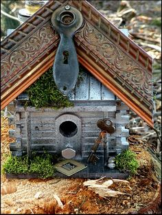 100 % Recycled Bird House    Recycled / Upcycled Handmade Bird House by UncommonRecycables    This Beautiful Bird House has been made with all Recycable Wares.    The peaks came from a Photo Gallery that went out of business. NO 2 Bird Houses are alike which makes these Bird Houses Unique and One of a kind! The ornate peaks are made from solid wood, ranging from 1 inch to 5 inches thick.