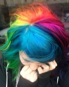 Ursula Goff's colourful wavy rainbow hair client