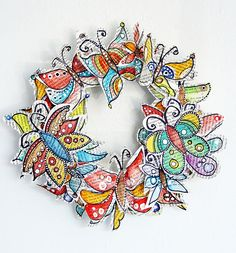 watercolor butterflies on old book pages...made into a wreath...beautiful.