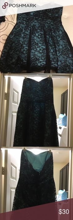 Doesn't fit anymore :) Beautiful homecoming/prom dress. Blue/real dress with black lace overlay. Strapless and VERY flattering. Just above knee-length. Bought from a local designer. Size 13/15 Dresses Prom
