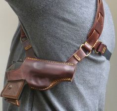 Side on view of the makeitjones custom leather Walther PPK Deluxe Spectre replica holster.