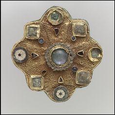Disk Brooch - gold, filigree, moonstone, garnets, mother-of-pearl (7th cent) - Frankish - The Met