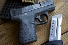 Much has been said about the Smith & Wesson M&P Shield. A true pocket-sized it's smaller in almost all dimensions (except height) than a Glock 26 and can easily be concealed … M&p 9mm, Revolvers, M&p Shield 9mm, Camouflage, Smith N Wesson, Smith And Wesson Shield, Home Defense, Cool Guns, Guns And Ammo