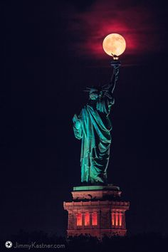 """viralthings: """" Last night's rare summer solstice full moon balancing on the Statue of Liberty's torch """""""