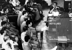 War and Conflict Angola. pic: June 1976. Luanda.The accused men in the dock, including Costas Georgiou (Colonel Tony Callan) at the show trial where 13 mercanaries, 10 of them British were being tried. A man points an accusing finger at one of the accused.