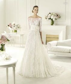 Beautiful Ellie Saab wedding dress. Love the neckline -S..