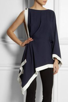 This heavy Jersey Black and White Asymmetrical Flowing Top is very elegant indeed. I would wear it for any kind of occasion and feel wonderful in it. Pure Sophistication Evie Miller. Fashion Advisor.