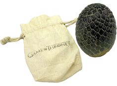 The Game of Thrones Dragon Egg Paperweight is a finely crafted piece of memorabilia. A resin-carved obelisk, the paperweight has aged details giving it an appearance of something you'd find on an anthropologist's desk. The Game of Thrones Dragon Egg Paperweight is a quality item for any fan. Comes in a Game of Thrones protective drawstring pouch.