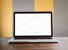 Ad: laptop open a blank white screen. by por.over on @creativemarket. The laptop open a blank white screen on brown wooden desk. The background is yellow and gray alternately beautiful. Used to put template #creativemarket Technology Photos, Wooden Desk, Blank White, Business Branding, Infographic, Smartphone, Laptop, Templates, Gray
