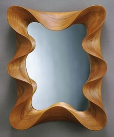 """This modern hand-crafted mirror is made to order andis carved from a single piece of cherry or walnut wood. Ideal for artistic decorating.  - Made of walnut or cherry wood,polished glass    - Height ( 15"""")  - Width ( 12"""")  - Depth ( 2"""")"""