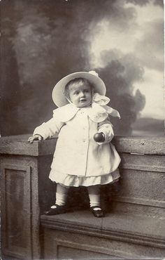 White coat, big white bow, toy ball, cute toddler, sweet girl, studio portrait, vintage child photo, Social History, vernacular (rppc/ch206)