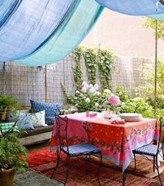 37 Awesome Bohemian Patio Designs. The light blue drape is lovely...