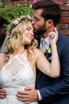 Sweet bride with modern lace wedding dress and flower crown