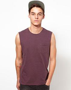5c8d90416d0639 ASOS Sleeveless T-Shirt With Pocket at asos.com