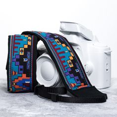 Camera Strap dSLR Tribal Southwestern.  This bright southwestern style camera strap will give your camera some style and color!  Comfortable 100% cotton, lightly padded camera strap in your choice of two lengths, end styles and pocket options.