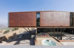 An open-top shipping container serves as a swimming pool (Photo: Sergio Pirrone)