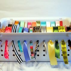How to Store Your Ribbons {organize} - great idea! On a shelf you can see all the ribbons, and even pull out what you need, without having to move the basket.