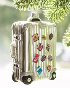 Vintage suitcase ornament perfect for jetsetters.