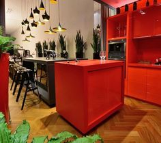 The lamps! Contemporary kitchrn. Black and red kitchen.