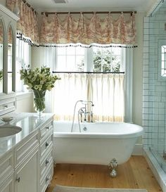 Country bathroom with beautiful window curtains.