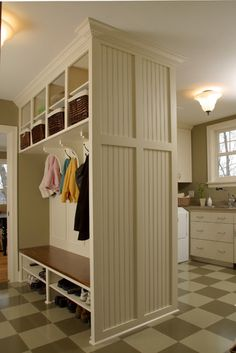 Exactly what I'm going for- add a ful length cabinet to each side, and loose the beadboard! Combination Mudroom and Laundry Room - traditional - entry - minneapolis - Ron Brenner Architects