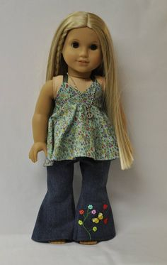 *THIS IS A HANDMADE ITEM AND IS NOT A LICENSED PRODUCT* Nothing says early 1970s like embroidered denim and halter tops - and this outfit has both! Your 18 doll will be totally groovy in these hip-hugger denim bell bottoms. They are hand embroidered just like we used to do back in the