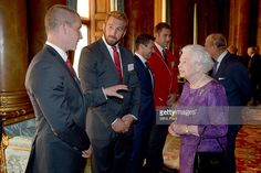 Queen Elizabeth II speaks with England Rugby Union head coach Stuart Lancaster (left) and England captain Chris Robshaw (second left) at a reception at Buckingham Palace to welcome Rugby World Cup stars on October 12, 2015 in London, United Kingdom.