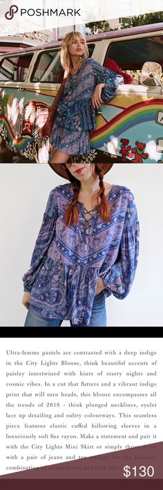 Celestial City Lights Blouse Ultra-femme pastels are contrasted with a deep indigo in the City Lights Blouse, think beautiful accents of paisley intertwined with hints of starry nights and cosmic vibes. In a cut that flatters and a vibrant indigo print that will turn heads, this blouse encompasses all the trends of 2018 - think plunged necklines, eyelet lace up detailing and sultry colourways. This seamless piece features elastic cuffed billowing sleeves in a luxuriously soft fine rayon…