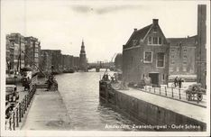 1940's. View on the Sint Anthoniesluis in Amsterdam. In the background the Oude Schans with the Montelbaantoren. On the right the sluice attendance house at the Jodenbreestraat. Photo Hema. #amsterdam #1940 #SintAnthoniesluis #Montelbaantoren