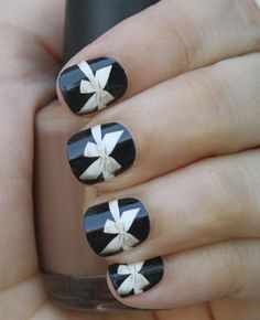 Bow Nail Wraps.... it doesn't look that hard to hand paint.... maybe just do one detailed nail.... and the rest as a single color!!! or a color with pretty tips and a stripe on them.....