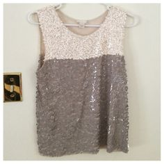 {J. Crew} Collection sequin colorblock tank Our designers covered this beautifully draped tank in thousands of shimmery rectangle sequins—to absolutely enchanting effect. It's unanimous here at headquarters: This is colorblocking at its best. Viscose. Loose fit. Hand wash. Great condition.  In Ivory.  No know missing sequins.  Last photo from J.crew.com & is to show style not actual color.  From retail J. Crew Tops Tank Tops