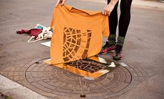 Using public street fixtures as printing elements, the artist collective behind Berlin-based Raubdruckerin (pirate printer) produces shirts and bags imprinted with manhole covers, vents, and utility grates. The overlooked geometric patterns and typographic forms of urban signage make surprisingly ni