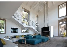 Located on Corsica, France, this 650m2 home by Festen Architecture features unique open beam ceiling.